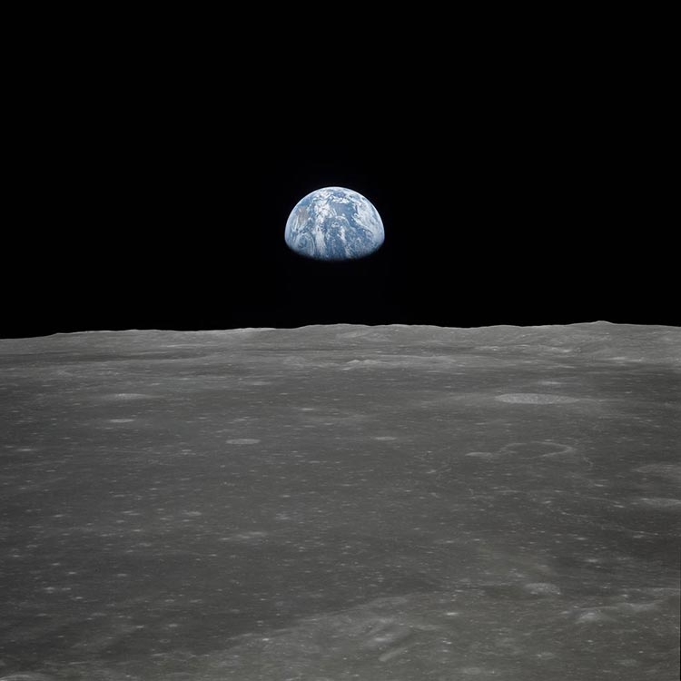 This view of Earth rising over the Moon's horizon was taken from the Apollo 11 spacecraft. The lunar terrain pictured is in the area of Smyth's Sea on the nearside. Photo: NASA