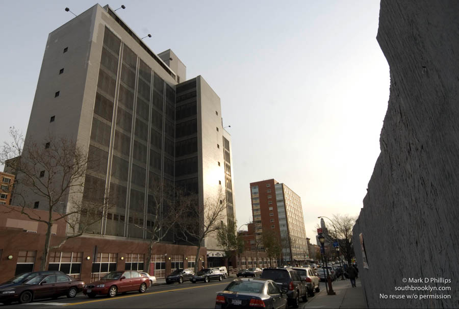 HIGH RISE JAIL<br><br>The Brooklyn House of Detention in Boerum Hill with boarded up properties across the street has stymied progress along that section of the thoroughfare. The addition of street level shops was completed years ago and remains empty. ©Mark D Phillips