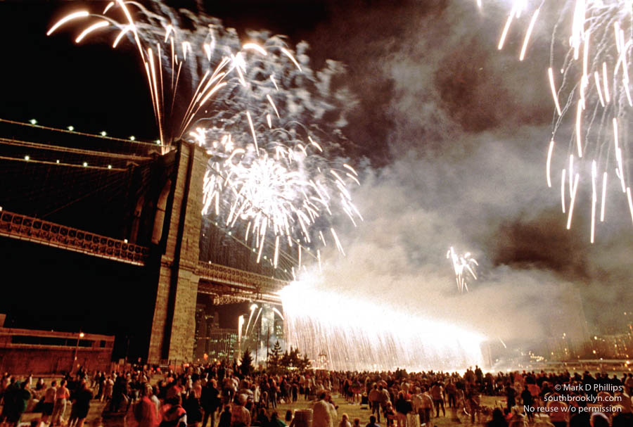 FIREFALL: Brooklyn Bridge 100th Anniversary on June 26, 1990 featured a fireworks waterfall as crowds watch from Empire-Fulton Ferry State Park in DUMBO. ©Mark D Phillips
