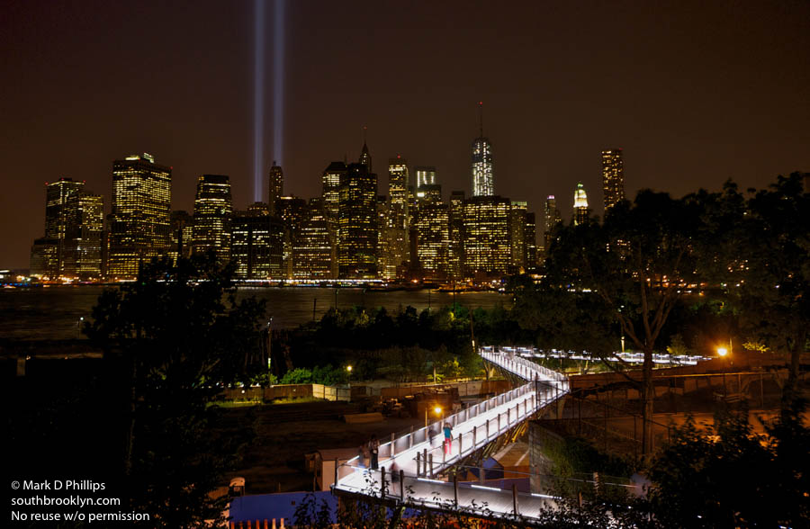 The Tower of Light tribute over the lower Manhattan skyline on the twelfth anniversary of 9/11 in 2013, looking across Brooklyn Bridge Park and the Squibb Park Bridge from the Heights Promenade. ©Mark D Phillips