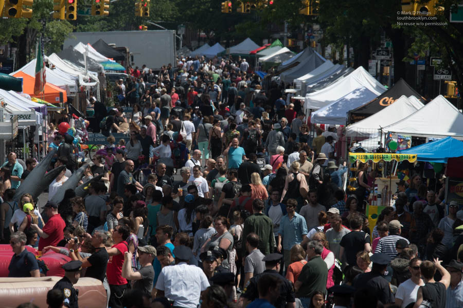 STREET FAIR MADNESS<br><br>The Fabulous Fifth Avenue Street Fair in Park Slope, Brooklyn, draws crowds that fill the street from edge to edge on May 20, 2018. ©Mark D Phillips