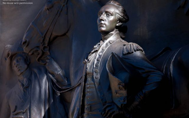A bronze sculpture depicting the Marquis de Lafayette by Daniel Chester French, sculptor of the Lincoln Memorial, stands at the Ninth Street entrance to Prospect Park in Park Slope. ©Mark D Phillips