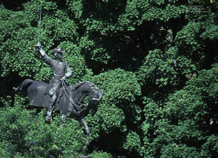 CAVALRY CHARGE<br><br>Grand Army Plaza in Park Slope features Union heroes of the Civil War including a statue of General Henry Warner Slocum charging through the trees. He fought at Bull Run, Georgia, the Carolinas and Gettysburg. In 1866, he moved to Brooklyn and was twice elected a US Representative. Unfortunately, Slocum's name is most recognizable as the steam excursion vessel that caught fire in the East River in June 1904, killing over a thousand German immigrants in the greatest NYC death toll in one day before the events of 9/11/01. ©Mark D Phillips
