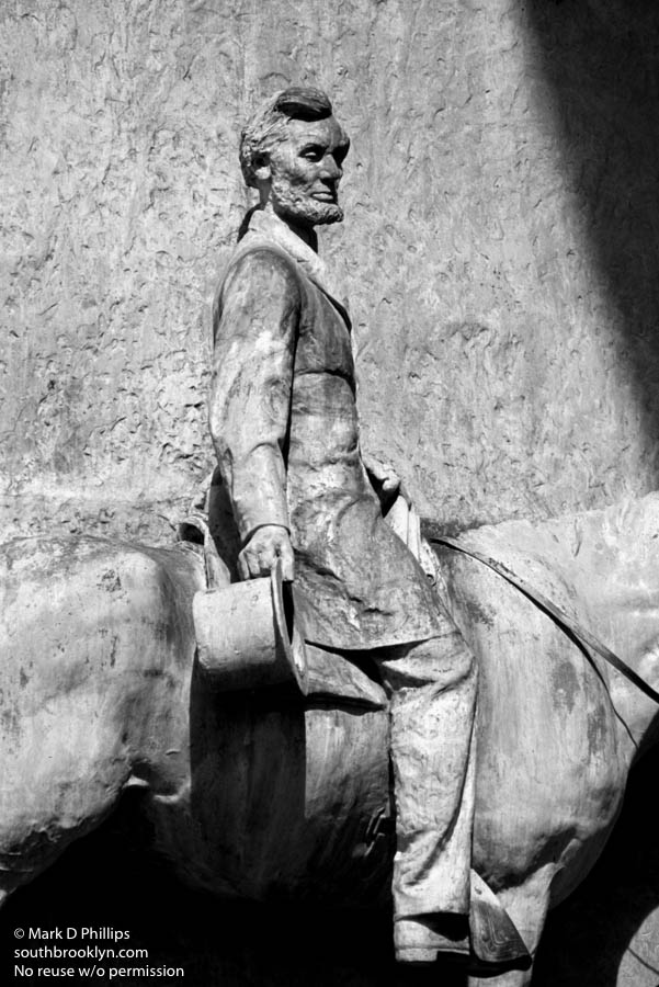 THE GREAT EMANCIPATOR<br><br>Frederick MacMonnies designed the three bronze sculptural groupings in 1894 for the Soldiers' and Sailors' Monument in Grand Army Plaza in Park Slope, Brooklyn. The interior arch faces have equestrian bas-reliefs of Abraham Lincoln and Ulysses S. Grant sculpted by William Rudolf O'Donovan (men) and Thomas Eakins (horses), that were added in 1895.. ©Mark D Phillips
