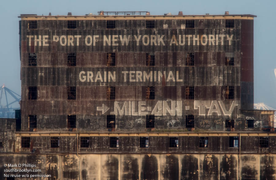 The Red Hook Grain Terminal is an abandoned grain elevator in the Red Hook adjacent to the mouth of the Gowanus Canal. In the summer of 2002, Zacho Dance Theater presented an aerial performance where dancers scaled the building and 100-foot (30 m) video images of Red Hook were projected on the terminal walls. ©Mark D Phillips
