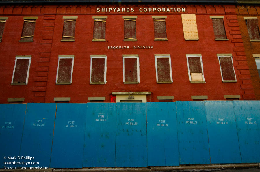 BILLION DOLLAR BOONDONGLE<br><br>The old Todd Shipyard buildings on Beard Street stand behind blue fences on March 8, 2006, just prior to destruction for the new Ikea. The Red Hook section of Brooklyn is seeing major change as urban renewal hits full force. ©Mark D Phillips
