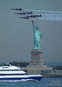 The US Navy Blue Angels pass in formation just above the Statue of Liberty in preparation for the Bethpage Federal Credit Union New York Air Show at Jones Beach on Saturday and Sunday, May 27-28, 2006. ©Mark D Phillips