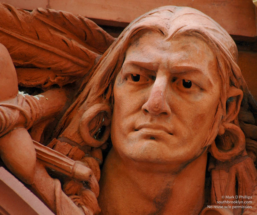 HISTORY IN RELIEF<br><br>Terra cotta figureheads by American sculptor Olin Levi Warner (1844-1896) depict Columbus, Benjamin Franklin, Shakespeare, Gutenberg, Beethoven and Michelangelo plus sculptures of a Viking and Indian adorn the archway of the Brooklyn Historical Society Building (1881) on Pierrepont Street in Brooklyn Heights. ©Mark D Phillips