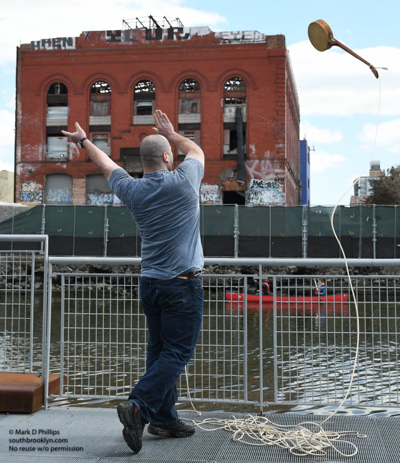 A TOXIC TOSS: Jarrad Morris competes in the Banjo Toss into the Gowanus Canal, part of the Brooklyn Folk Festival on April 8, 2018. ©Mark D Phillips