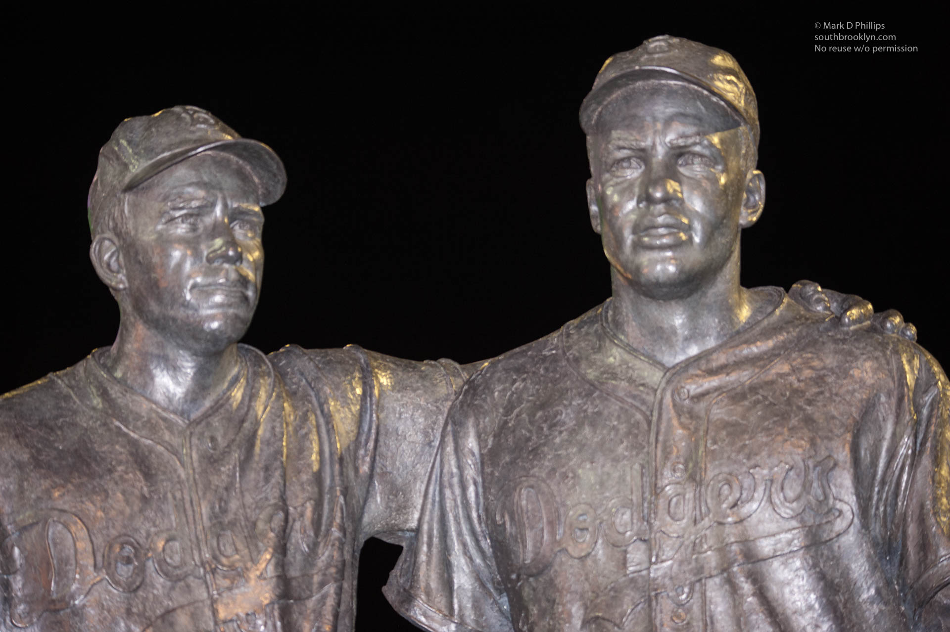 PeeWee Reese and Jackie Robinson statue in Coney Island stands outside the home of the Brooklyn Cyclones minor league stadium. ©Mark D Phillips
