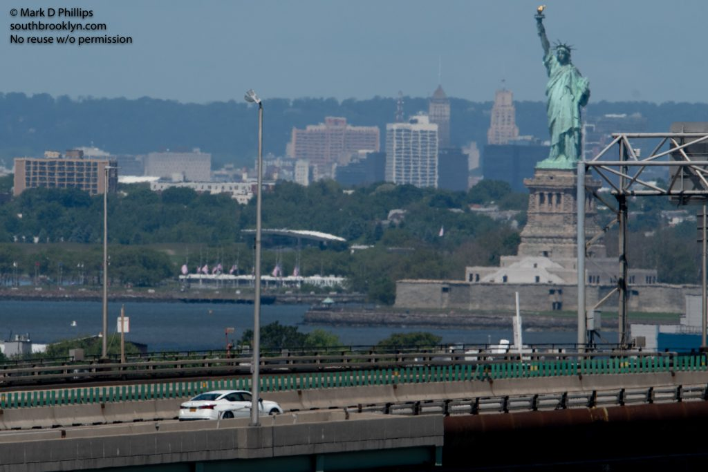 New York City on May 30, 2020, during the Covid-19 pandemic, Gowanus Expressway with one car and the Statue of Liberty on a Saturday afternoon.