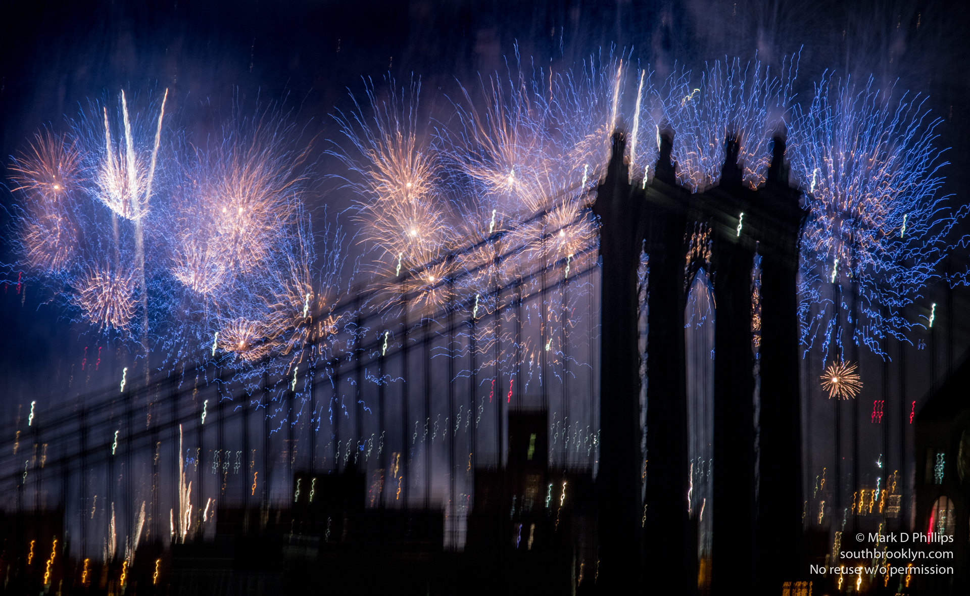 Fireworks and a majestic bridge come together to give a different look to the Macy's Fourth of July fireworks 2017 in New York City. Blue fire over a ghostly city. ©Mark D Phillips