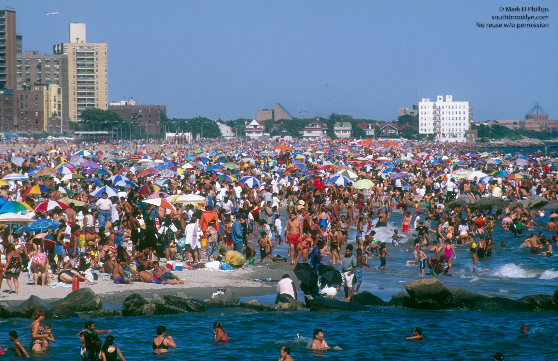 Fourth of July on the beach at Coney Island in 1990. ©Mark D Phillips