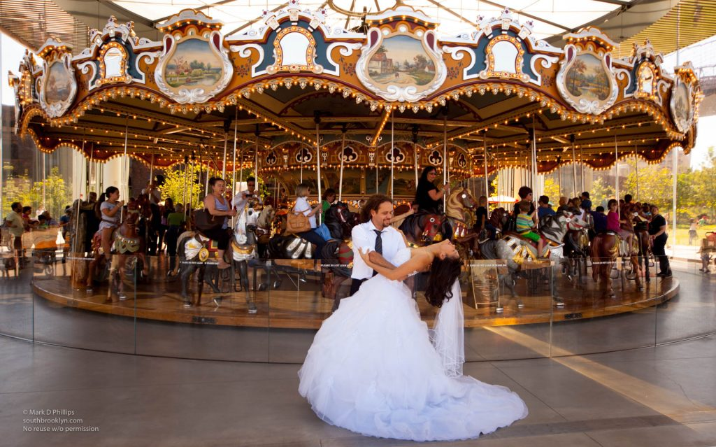 Bride and Groom at Jane's Carousel in Brooklyn Bridge Park. ©Mark D Phillips