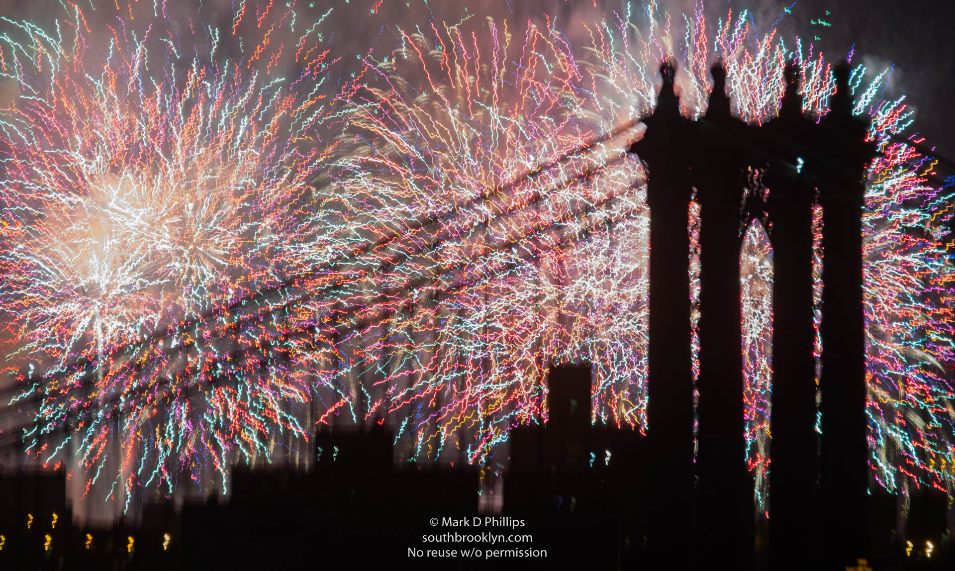 Fireworks and a majestic bridge come together to give a different look to the Macy's Fourth of July fireworks in New York City. A frenzy of colors fill the sky behind the Manhattan Bridge. ©Mark D Phillips