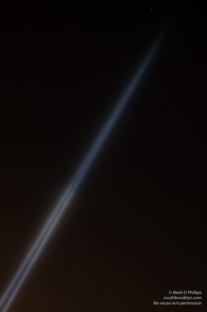 Tribute in Light memorial to 9/11 blazes into the sky towards the star Deneb above New York City. ©Mark D Phillips