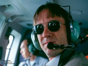 Mark D Phillips in helicopter over Qutang Gorge and the Yangtze River on October 28, 1995. ©Mark D Phillips