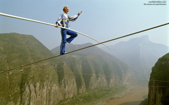 "Jay Cochrane, ""The Prince of the Air"", completes The Great China Skywalk over the Yangtze River in Qutang Gorge, China, on October 28, 1995. The skywalk was and is the greatest ever made spanning half a mile between the canyon walls and 1,340 feet above the river. ©Mark D Phillips"