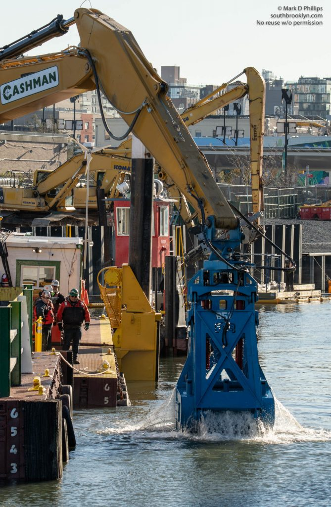 EPA begins dredging the Gowanus Canal in November 2020 by the Carroll Street Bridge. The current cost of the overall cleanup plan is estimated to be over $1.5 billion, and the entire project won't be completed until mid-2023. ©Mark D Phillips