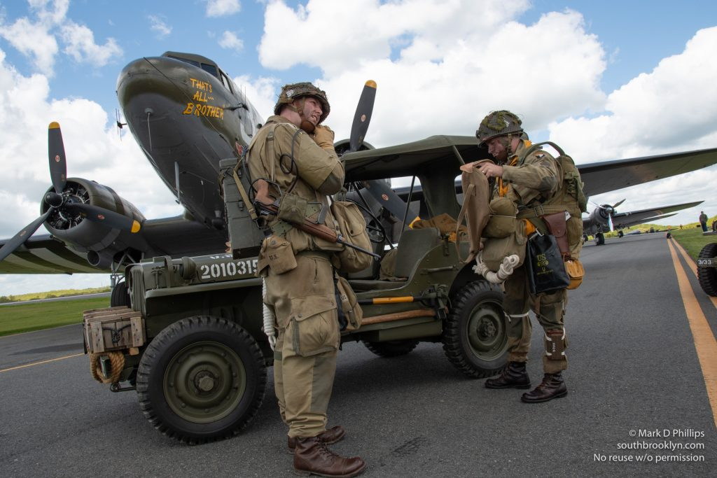 World War II reenactors will jump from the planes over Normandy in the anniversary celebration. ©Mark D Phillips