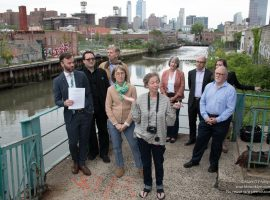 Linda Mariano is front and center as Activists and community groups gather on the Union Street bridge to advocate for Landmarking and preserving the original architecture in the Gowanus Canal district.