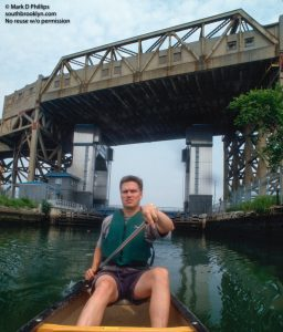 Owen Foote paddles on the Gownaus Canal in 1990s, a pastime that has grown into the Gowanus Dredgers.