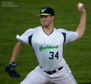 Jack Choate of Assuption College pitches during the Worcester Bravehearts opening night on May 26, 2021. Photo by Mark D Phillips