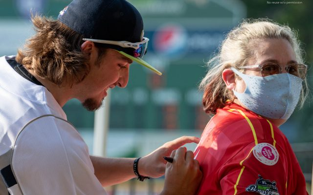 Worcester Bravehearts Jared Kapurch autographs Leah Goldstein's jersey during opening night on May 26, 2021. Photo by Mark D Phillips