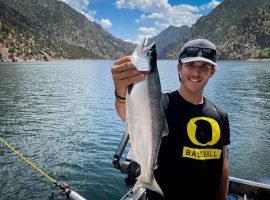 Colorado June 24, 2021: Chuck Bigger nephew Gabe Chambless holds a Kokanee Salmon on Morrow Point Reservoir. ©Chuck Bigger