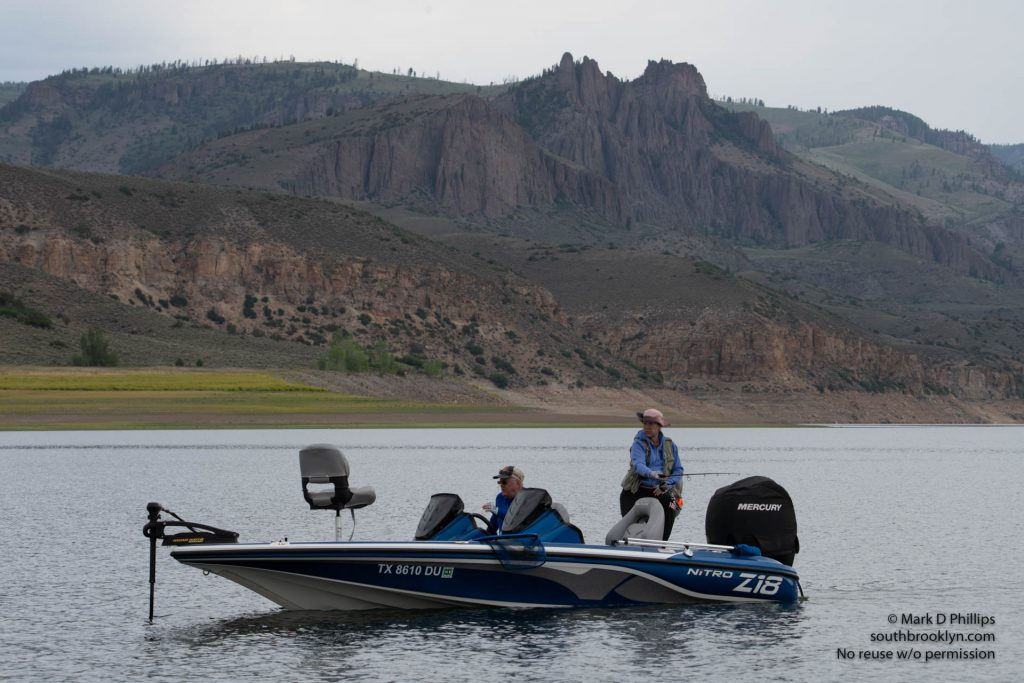 Colorado June 23, 2021: Fishing the main channel of Blue Mesa Reservoir in Colorado with the Dillon Pinnacles looming on the shoreline. ©Mark D Phillips