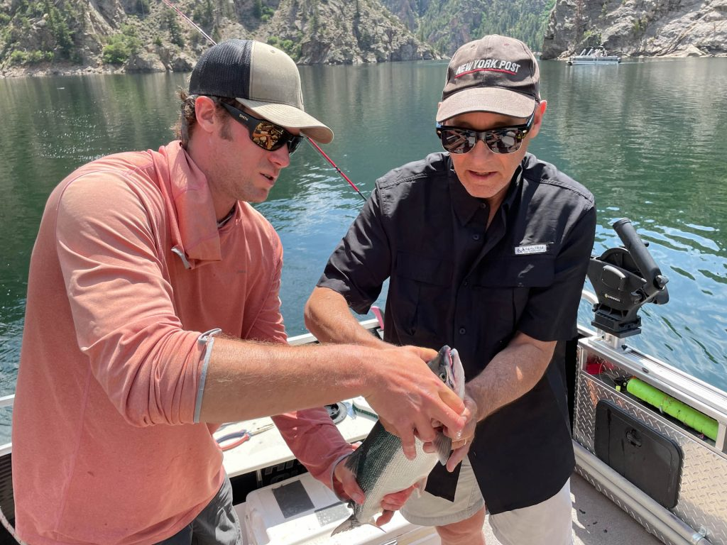 Colorado June 24, 2021: Mark D Phillips with guide, Kyle Jones, on Morrow Point Reservoir. ©Chuck Bigger