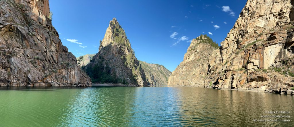 Colorado June 24, 2021: Approaching the 700-foot granite Curecanti Needle on Morrow Point Reservoir in the Black Canyon of the Gunnison in a 3/4 panorama. ©Mark D Phillips